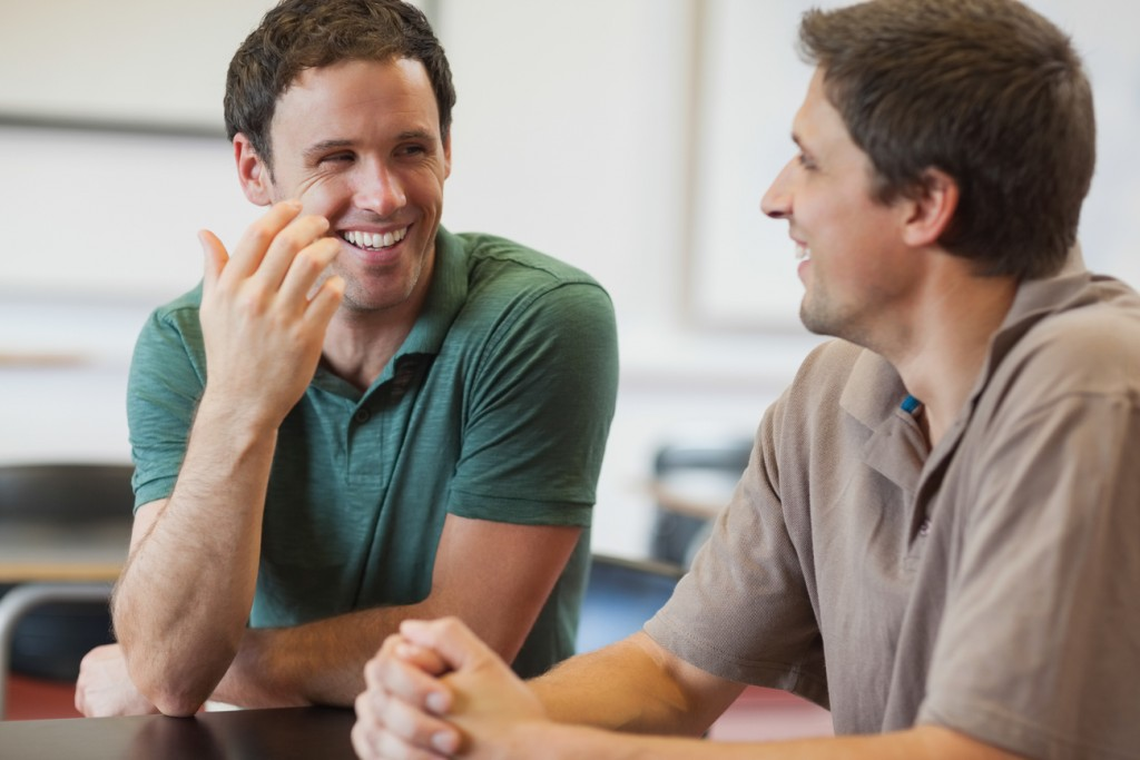 A gay couple is having a conversation about HIV prevention methods.